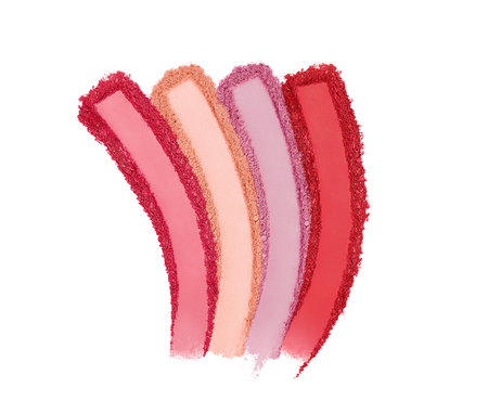 Foto de Cosmetics. Crushed Eyeshadow And Blush On White Background. Close Up Of Colorful Matte Makeup Powder. Cosmetics Swatches. High Quality Image. - Imagen libre de derechos