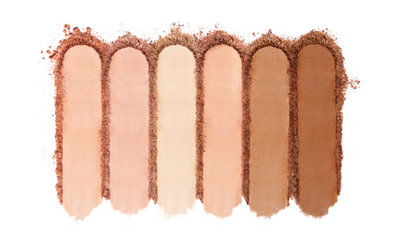 Foto de Crushed Powder Foundation For Makeup. Close Up Of Different Shades Of Broken Powder On White Background. Beauty Cosmetics Products. High Quality Image. - Imagen libre de derechos