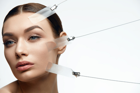 Photo pour Beauty Woman Face During Face Skin Lift Treatment On White Background. High Resolution. - image libre de droit