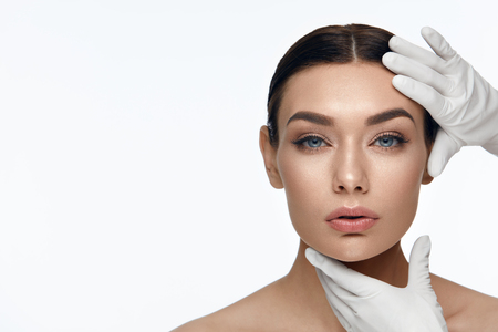 Photo pour Beauty Face Skin Care. Beautiful Woman Face Before Operation Cosmetic Treatment On White Background. High Resolution. - image libre de droit