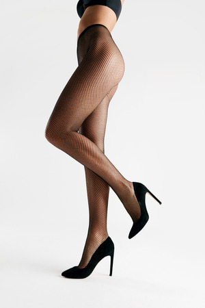 Photo pour Black Tights. Female With Long Legs Wearing Stylish Pantyhose On White Background. High Resolution. - image libre de droit