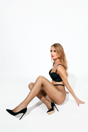 Photo pour Sexy Woman In Black Fishnet Tights. Beautiful Female With Fit Body In Stockings On Long Legs. High Resolution. - image libre de droit