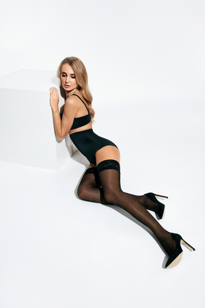 Photo pour Sexy Female In Stylish Stockings And Black Lingerie On White Background. High Resolution. - image libre de droit
