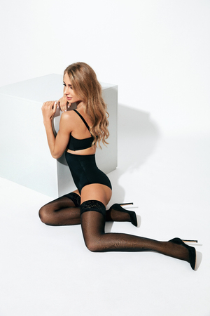 Photo for Sexy Female In Stylish Stockings And Black Lingerie On White Background. High Resolution. - Royalty Free Image