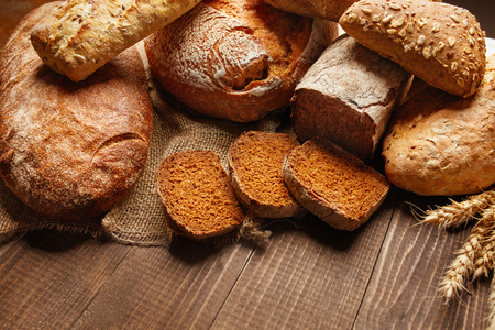Photo pour Bakery. Bread On Wood Background. Closeup Of Variety Of Baked Food On Wooden Table. High Resolution - image libre de droit