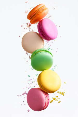 Foto de Macaron Sweets. Colorful Macaroons Flying. French Dessert In Motion Falling On White Background. High Resolution - Imagen libre de derechos