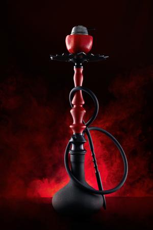 Photo for Pomegranate Shisha With Red Smoke On Black Background. - Royalty Free Image