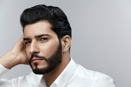Foto de Fashion Man Portrait. Male Model With Hair Style And Beard - Imagen libre de derechos