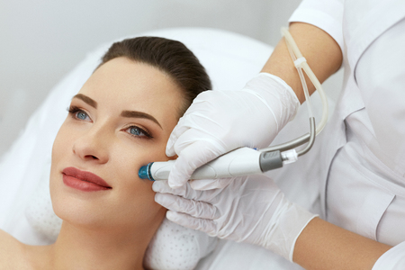 Photo pour Face Skin Care. Closeup Of Woman Face Cleansing At Cosmetology. Beauty Procedure For Deep Skin Cleansing With Hydro Vacuum. High Resolution - image libre de droit
