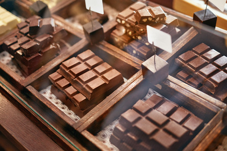 Photo for Chocolate Bars In Confectionery Shop Closeup. Handmade Chocolate On Wooden Showcase In Workshop. High Resolution - Royalty Free Image