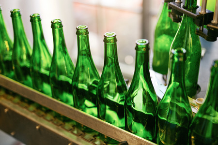Photo for Beer Brewing Process On Brewery. Glass Bottles For Craft Beer On Conveyor. High Resolution - Royalty Free Image