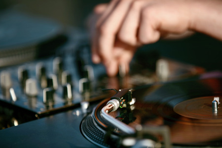 Photo for DJ Mixing Music Track On Festival. Deejays Hands On Professional Music Equipment Closeup. High Resolution - Royalty Free Image