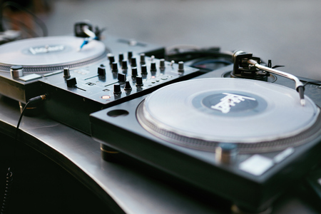 Photo for DJ Equipment On Table Closeup. DJ Control Panel For Playing Music. High Resolution - Royalty Free Image