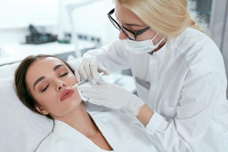 Foto de Face Injections. Beautician Doing Facial Lifting Procedure, Beauty Injection At Clinic. High Resolution - Imagen libre de derechos