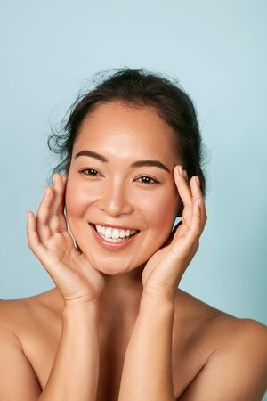 Photo for Beauty face. Smiling asian woman touching healthy skin portrait - Royalty Free Image