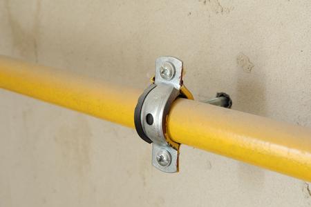 Photo pour Yellow gas pipe connection flange joints close up - image libre de droit
