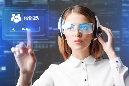 Foto de Young businesswoman working in virtual glasses, select the icon customer experience on the virtual display. - Imagen libre de derechos