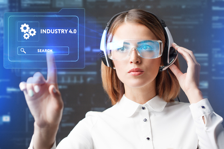 Foto de Young businesswoman working in virtual glasses, select the icon industry 4.0 on the virtual display. - Imagen libre de derechos