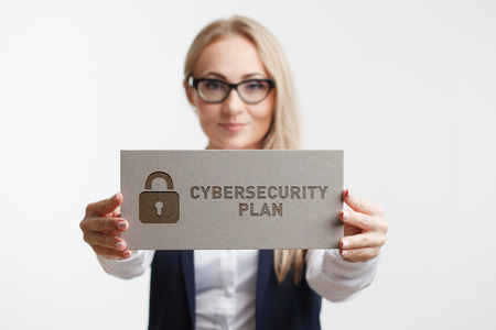 Photo pour Business, Technology, Internet and network concept. Young girl holding a sign with an inscription CYBERSECURITY PLAN. - image libre de droit