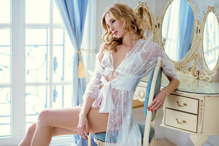 Foto de Beautiful sexy lady in elegant white robe - Imagen libre de derechos