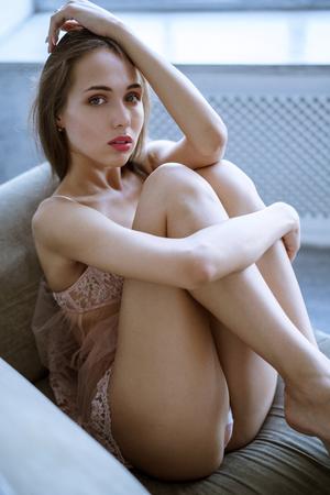Photo pour Fashionable female portrait of cute lady in pink robe indoors - image libre de droit
