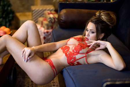 Foto de Beautiful brunette sexy Santa Clause in elegant panties and bra - Imagen libre de derechos