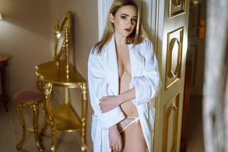 Foto de Beautiful sexy lady in elegant white robe - Imagen libre de derechos