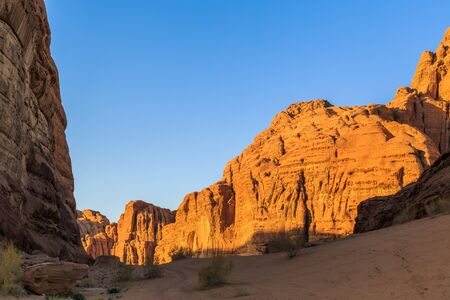 Scenic view of the yellow colored mountain rocks in the Wadi rum desert in Jordan at early-morning sunrise