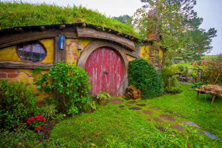 Photo for NORTH ISLAND, NEW ZEALAND- MAY 16, 2017: Hobbit house with red door, hobbiton movie set, site made for movies: Hobbit and Lord of the ring in Matamata, north island of New Zealand - Royalty Free Image