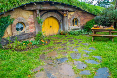Photo for NORTH ISLAND, NEW ZEALAND- MAY 16, 2017: Hobbit house with yellow door, hobbiton movie set, site made for movies: Hobbit and Lord of the ring in Matamata, north island of New Zealand - Royalty Free Image