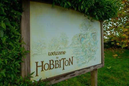 Photo for NORTH ISLAND, NEW ZEALAND- MAY 16, 2017: Welcoming board by the entrance to Hobbiton Village at Hobbiton Movie Set - Royalty Free Image
