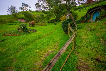 Photo for NORTH ISLAND, NEW ZEALAND- MAY 16, 2017: House with blue door at Hobbiton Movie set, New Zealand - Royalty Free Image