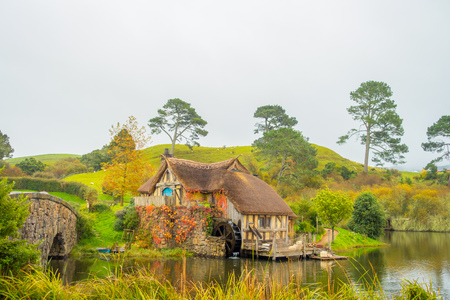 Photo for NORTH ISLAND, NEW ZEALAND- MAY 16, 2017: Water mill in Hobbiton, site made for movies: Hobbit and Lord of the ring in Matamata, north island of New Zealand - Royalty Free Image