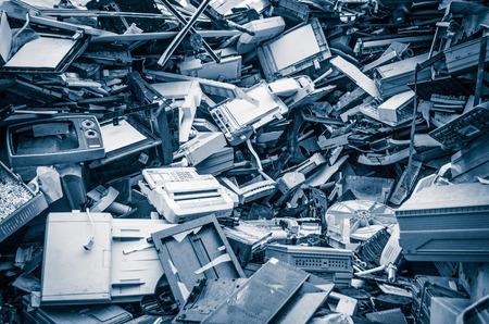 Foto de Heap of old scrap metal mainly consist of household appliance in a scrap yard - Imagen libre de derechos