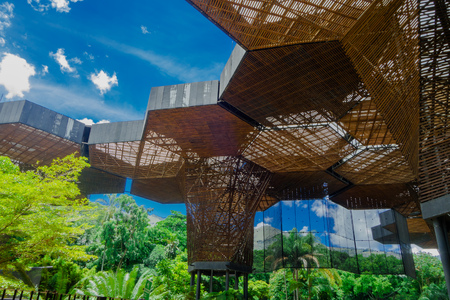 Photo for MEDELLIN, COLOMBIA OCTOBER 22, 2017: Beautiful architectural woodden structure in a botanical greenhouse in Medellin - Royalty Free Image