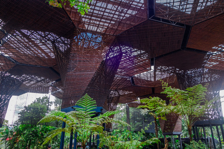 Photo for Beautiful architectural woodden structure in a botanical greenhouse in Medellin - Royalty Free Image