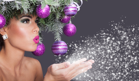 Foto de Christmas fashion model woman. Xmas New Year hairstyle and make up - Imagen libre de derechos