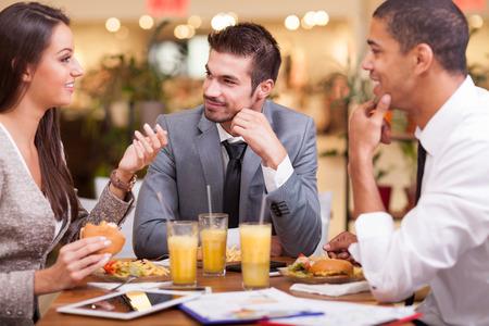 Photo pour office workers on lunch at the restaurant - image libre de droit
