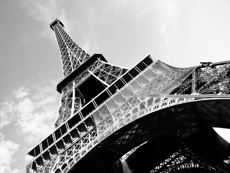 Foto de Detailed bottom view of Eiffel tower, Paris, black and white image - Imagen libre de derechos