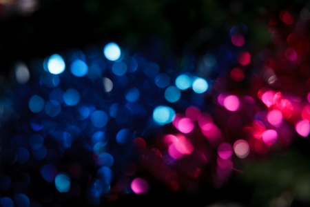 Foto de Abstract christmas background. Holiday colored lights unfocused - Imagen libre de derechos