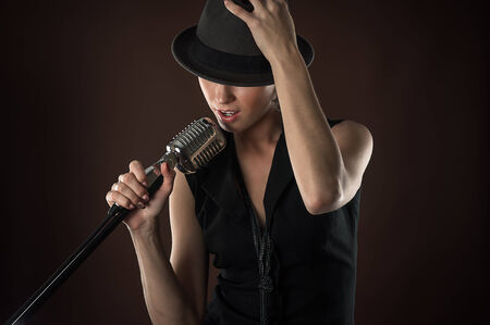 Photo for fashionable woman in a hat with a retro microphone - Royalty Free Image