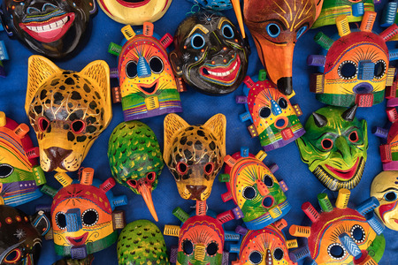 Foto de Otavalo, Ecuador - February 17, 2018:  closeup of colourful indigenous wood carvings in the Saturday artisan market - Imagen libre de derechos