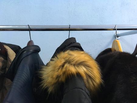 Foto de winter clothes hanging on a metal coat hanger - Imagen libre de derechos