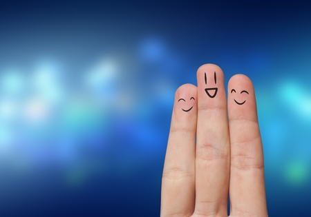 Photo pour Finger hug with Abstract Lights and painted smiley - image libre de droit