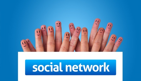 Happy group of finger smileys holding whiteboard with social network sign