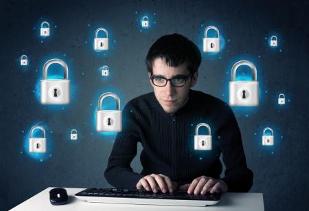 Foto de  Young hacker with virtual lock symbols and icons on blue background - Imagen libre de derechos