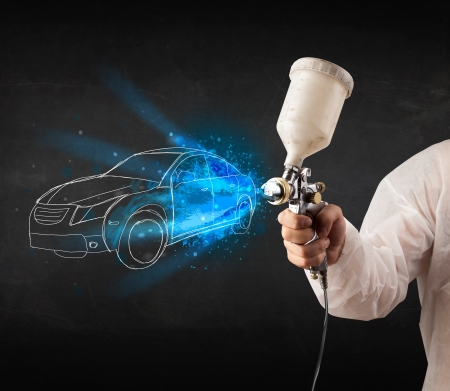 Photo for Worker with airbrush gun painting hand drawn white car lines - Royalty Free Image