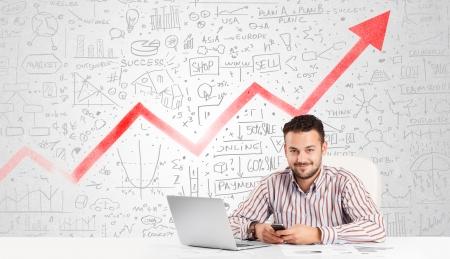 Foto für Business man sitting at table with market hand drawn diagrams  - Lizenzfreies Bild