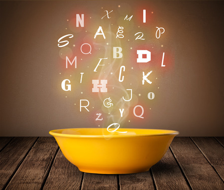 Photo pour Colorful letters coming out of home cook soup bowl on wood deck - image libre de droit