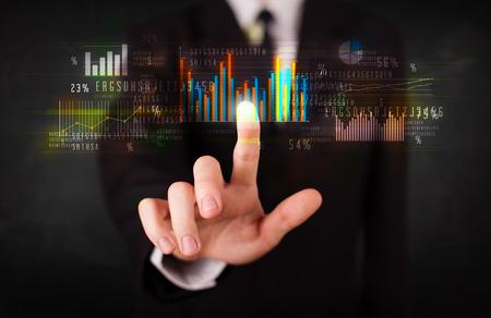 Foto de Business person touching colorful charts and diagrams - Imagen libre de derechos